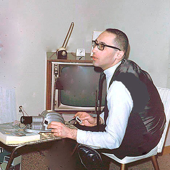 Irv with a slide projector in 1965